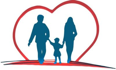 Family walking through a drawn heart